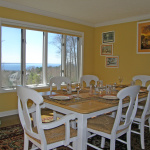Enjoy the view of Lake Michigan while having meals around the dining room table.