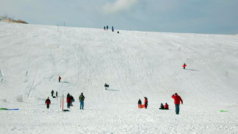 Sledding at the Dune Climb in Sleeping Bear Dunes National Shoreline (National Park Service/CC BY 2.0)